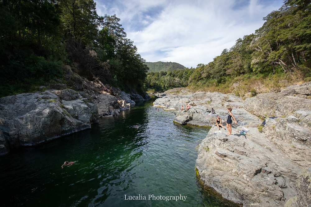 gorge with swimmers in the water and on the rocks, Wairarapa photographer