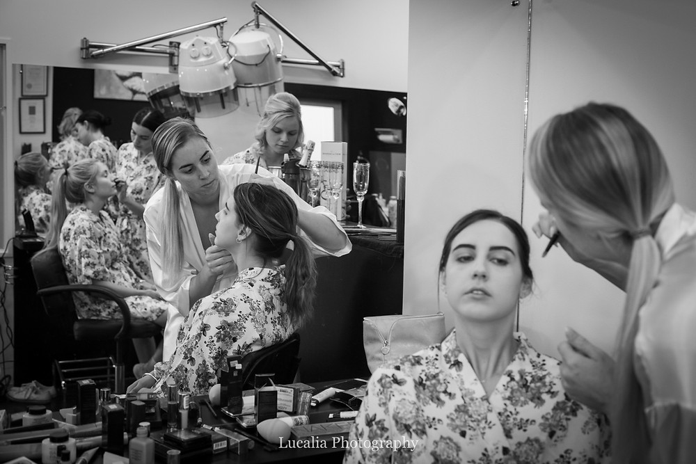 bride and bridesmaids doing make up getting ready, Wairarapa wedding photographer