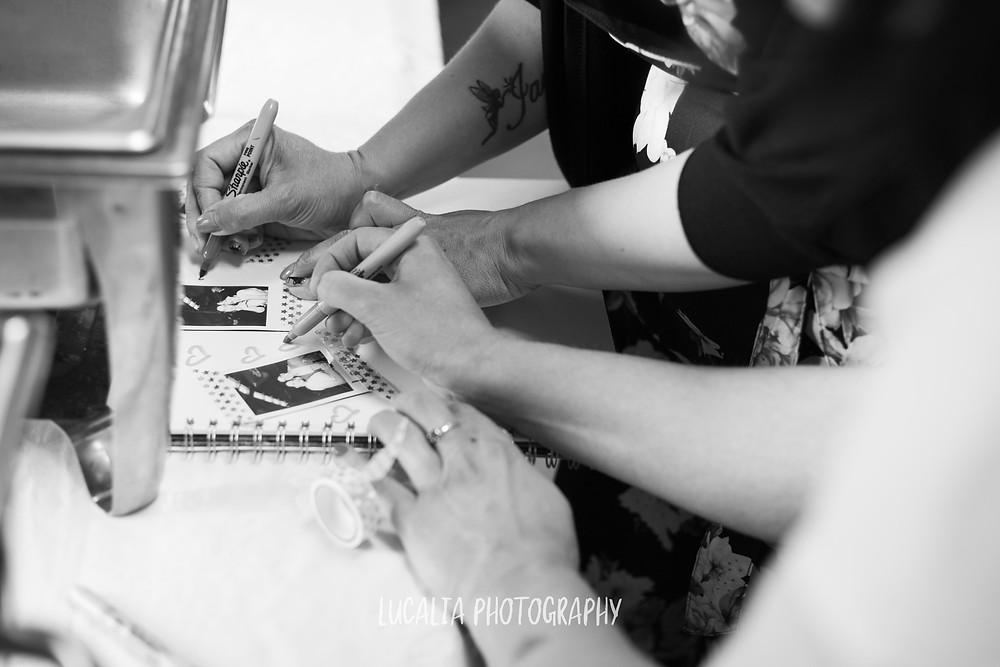 wedding guests with polaroid photos, Wedding venue, Waimeha Bar and Grill, Ngawi Wairarapa wedding photographer