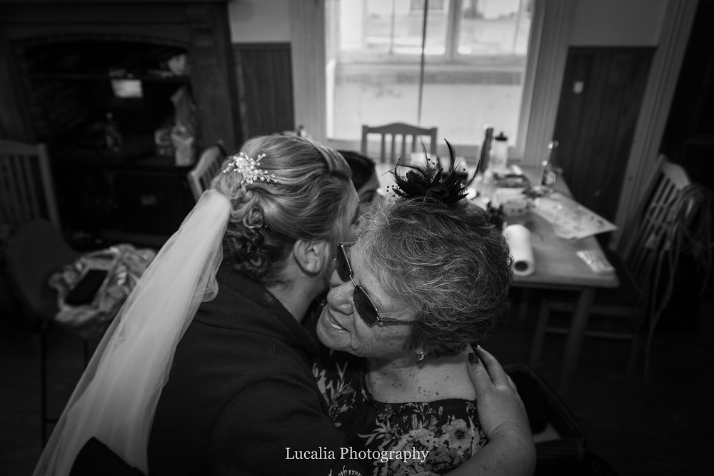 mother of the bride and bride hug, Wairarapa wedding photographer