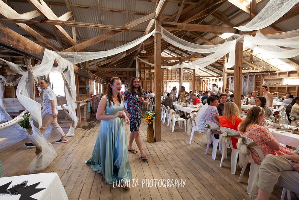 bride walking into the Woolshed, Wairarapa rustic wedding venue