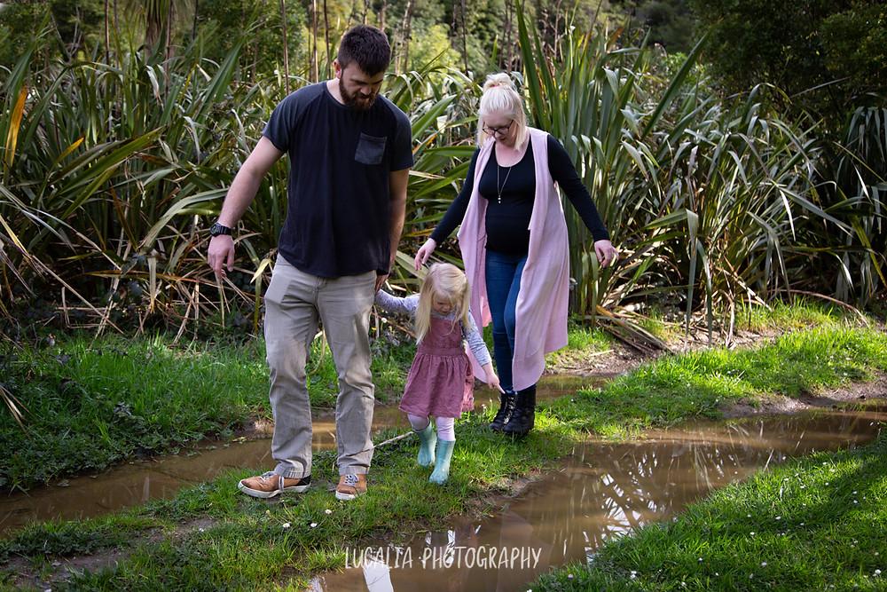 family walking on muddy track balancing on grass, Wairarapa family photographer