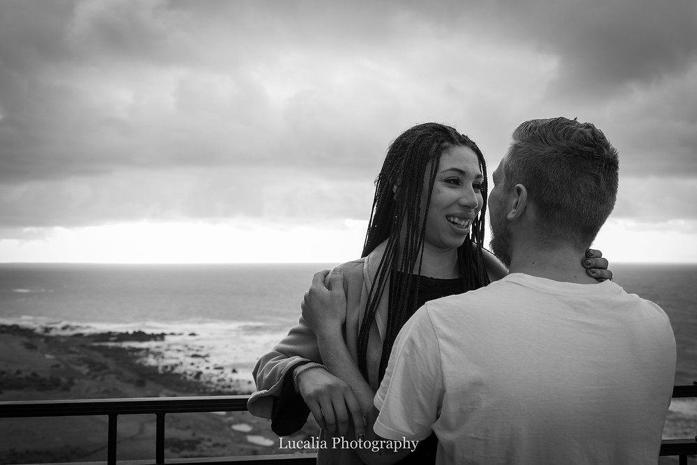 bride to be looking into the eyes of her husband to be overlooking the sea, Cape Palliser, Wairarapa