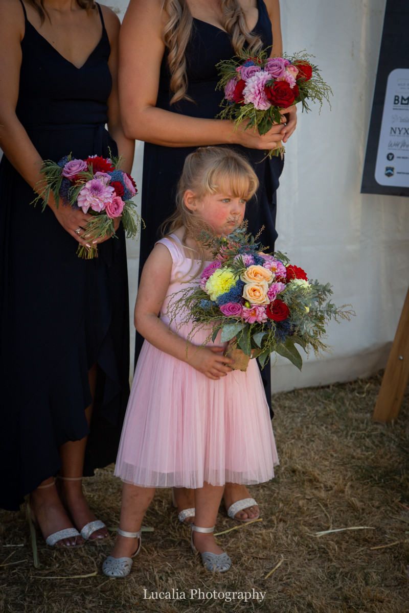 flower girl holding bridal bouquet, Wairarapa