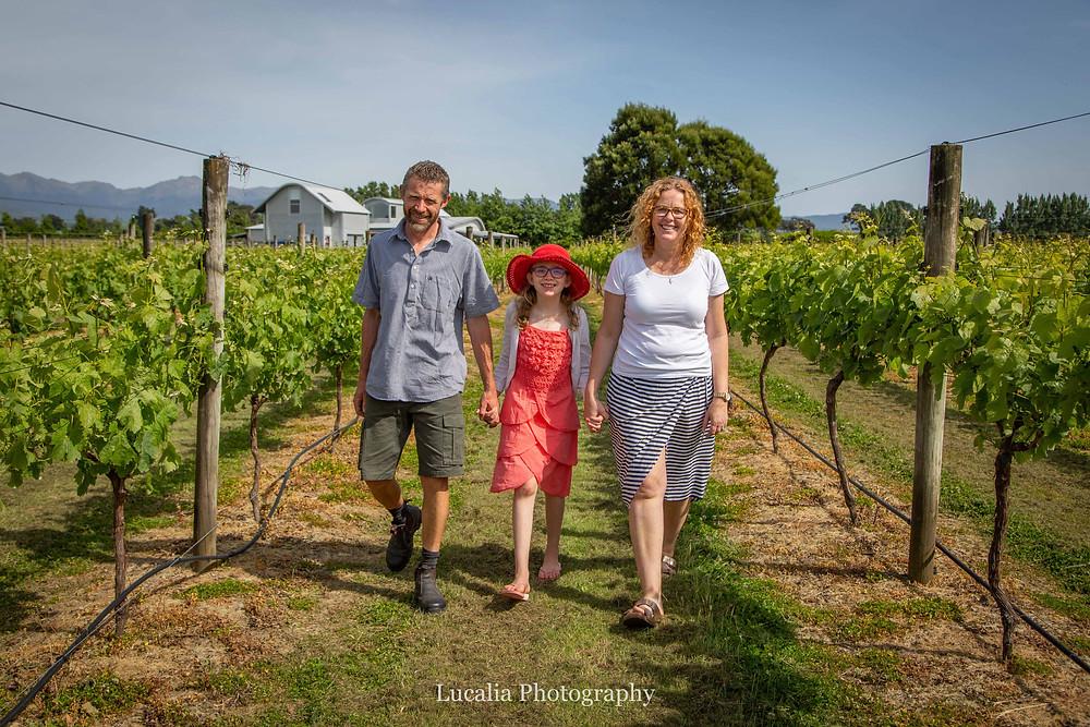 family walking through a vineyard, Wairarapa family photographer