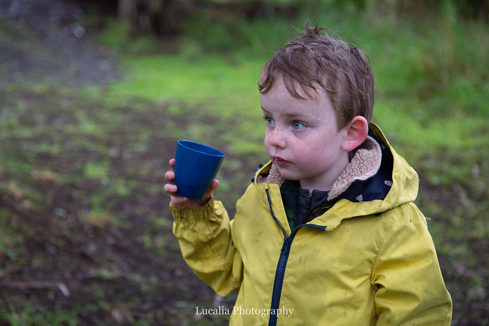 boy with wide eyes pauses whilst drinking from a blue cup, Wairarapa family photographer