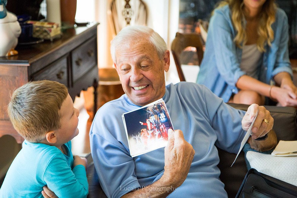 grandfather showing his grandson a photo on the day of his grandaughter's wedding, Wairarapa