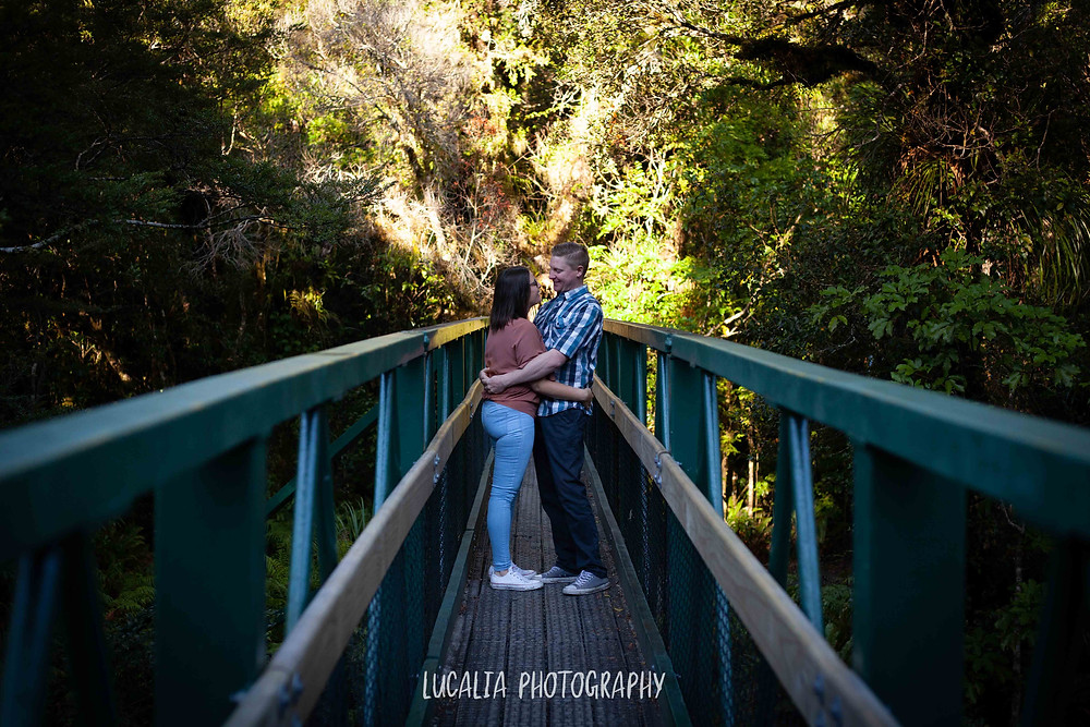engaged couple on a green bridge, Mt Holdsworth, Wairarapa wedding photographer