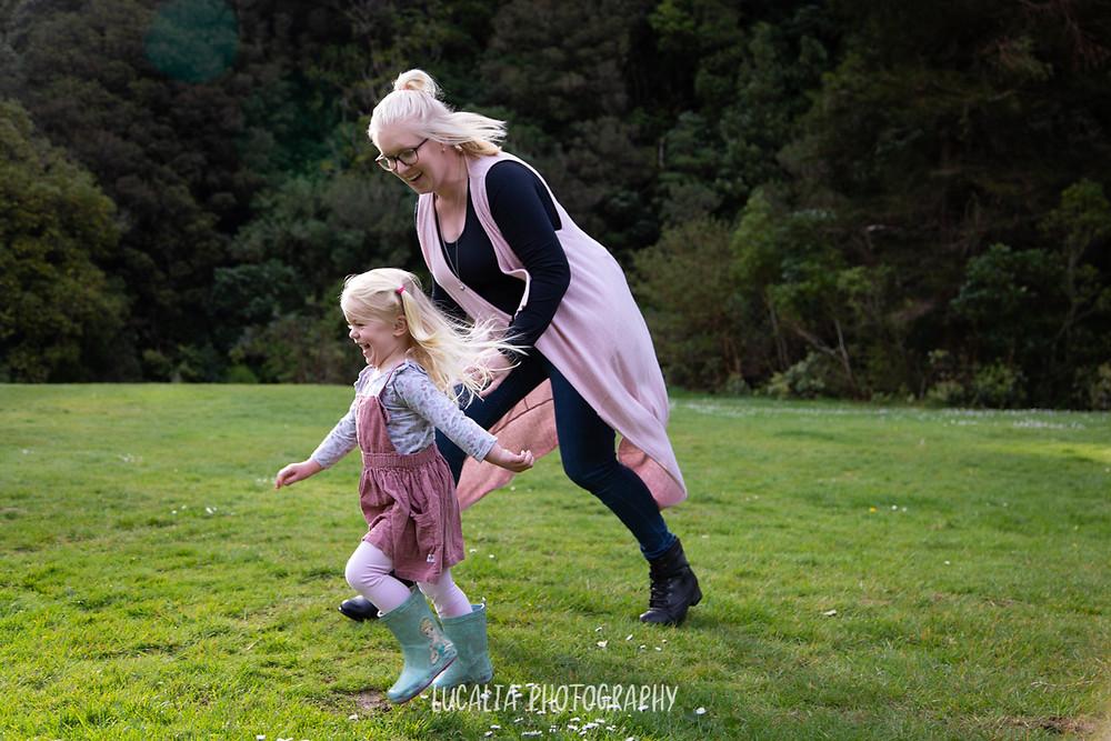 mum running with her daugher on grass, Wairarapa family photographer