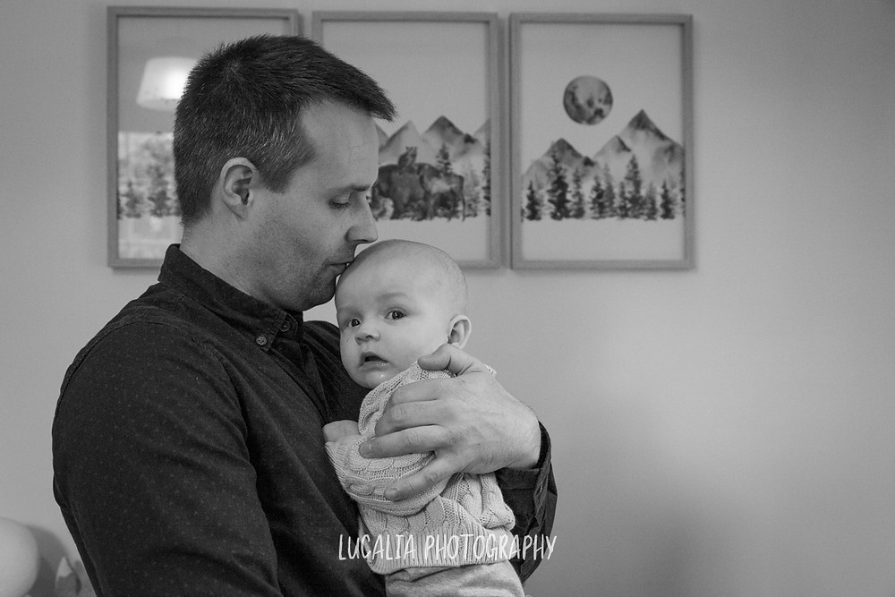 dad kissing son's forehead with forest prints in background, Mount Holdsworth, Wairarapa family photographer