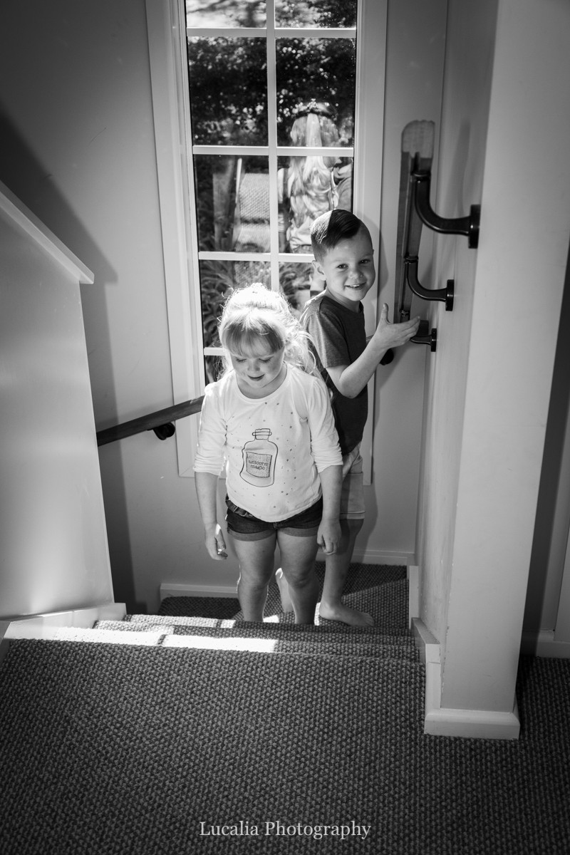 wedding couple's children climbing the stairs, Wairarapa