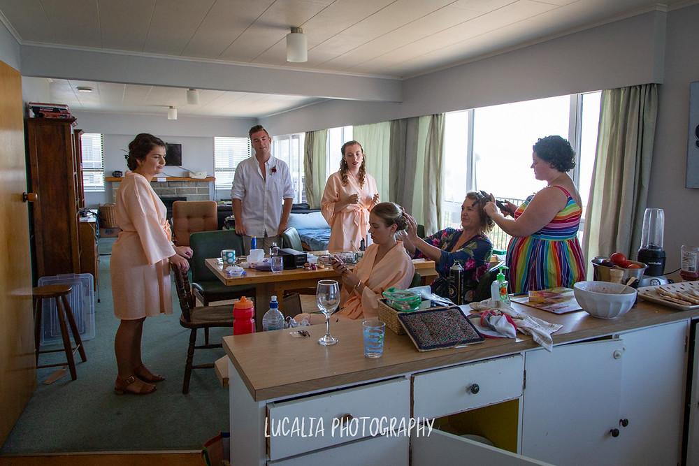 wedding party doing hair, Castlepoint Wairarapa wedding, Lucalia Photography