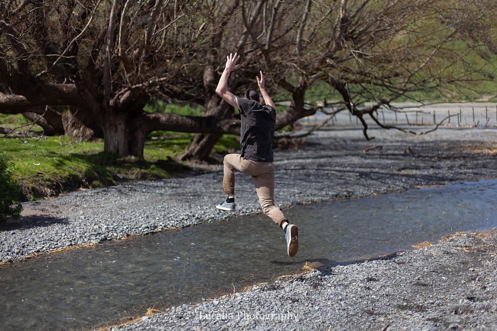 groom jumping a river, Wairarapa wedding photographer