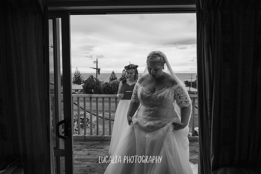 bride walking from verandah inside, Ngawi Wairarapa wedding photographer