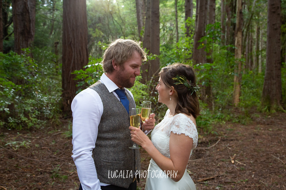 bride and groom drinking Le Gra sparkling wine at Kiriwhakapapa redwood forest, Wairarapa wedding photographer