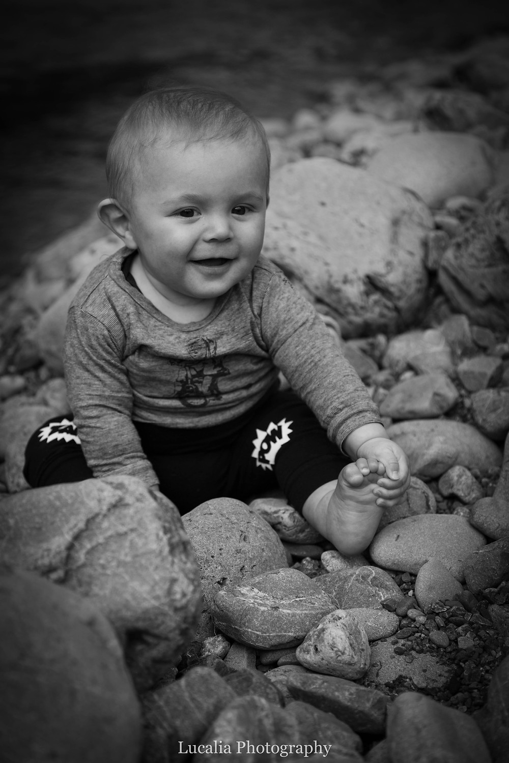 6 month old baby sitting on rocks, Tararua Forest Park, Wairarapa family photographer