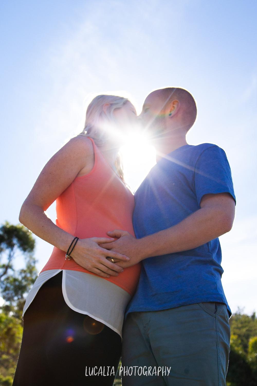 pregnant couple kissing with sunburst Wairarapa maternity phototographer