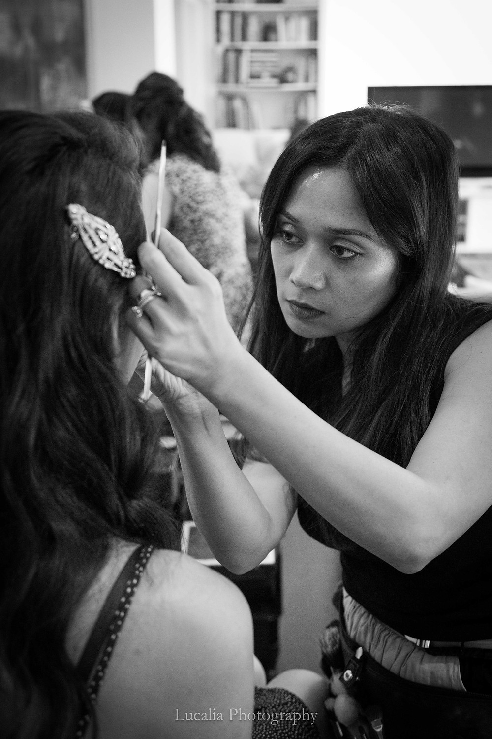 Cay Duque applying makeup to a bride in NSW