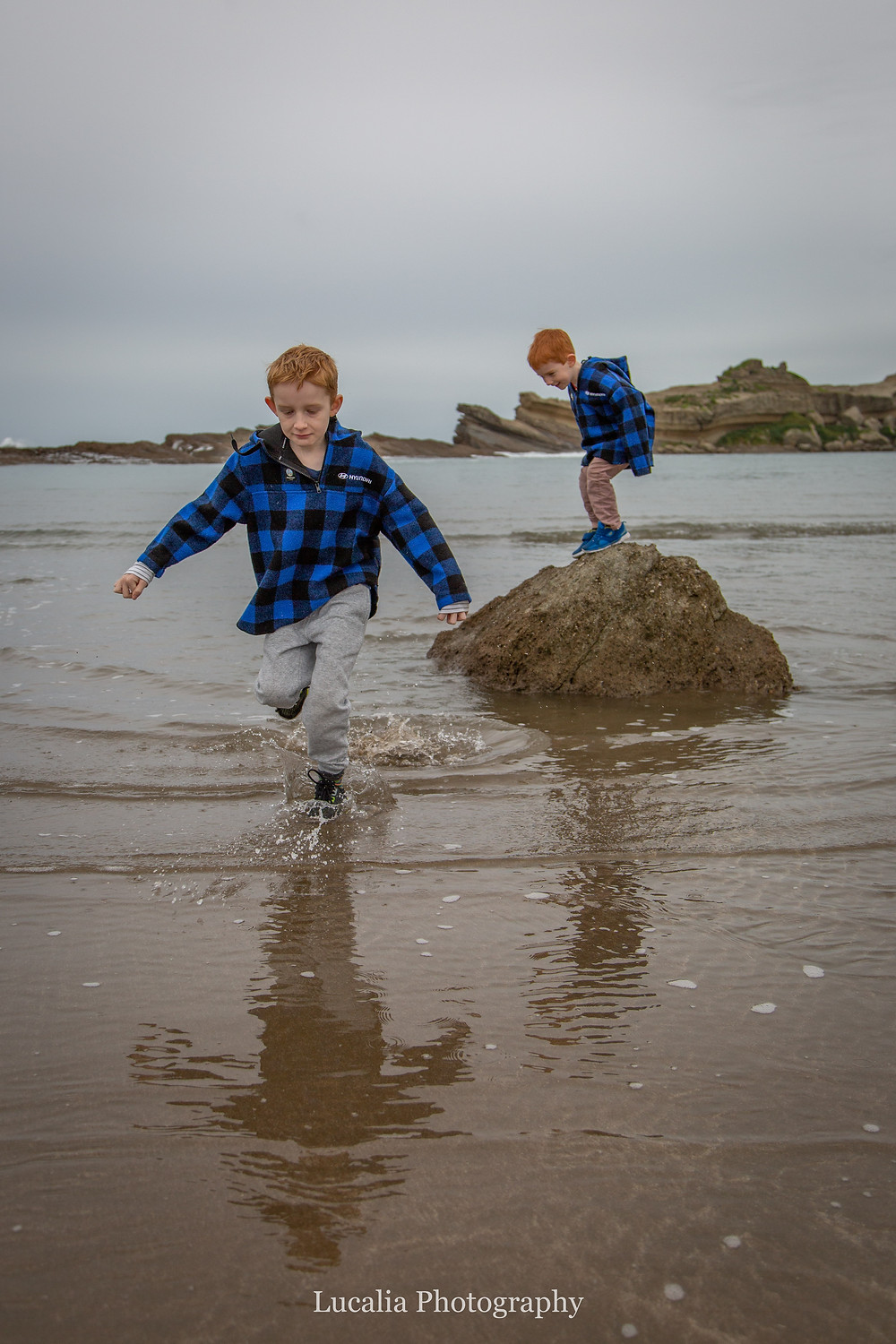 boys running through the water, Castlepoint Wairarapa family photographer