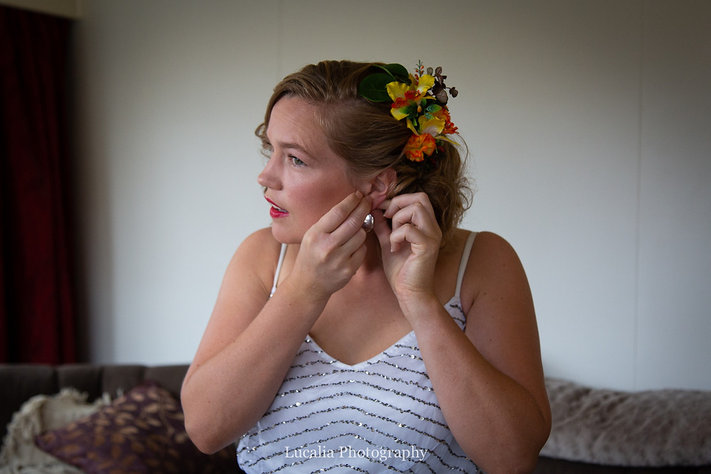 bride puts on wedding earrings, Wairarapa wedding photographers