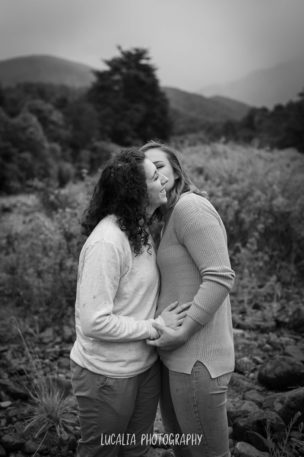 engaged couple hugging by the river at Mt Holdsworth, Wairarapa wedding photographer