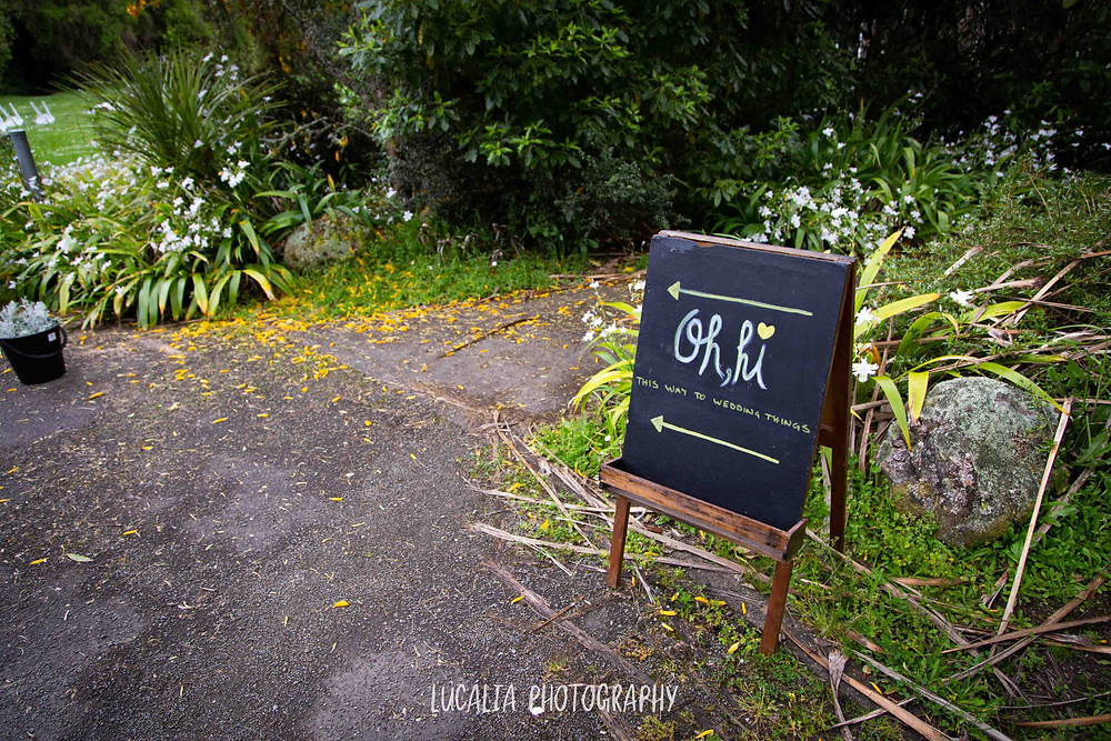 chalkboard welcoming guests to an outdoor wedding, Wairarapa wedding photographer