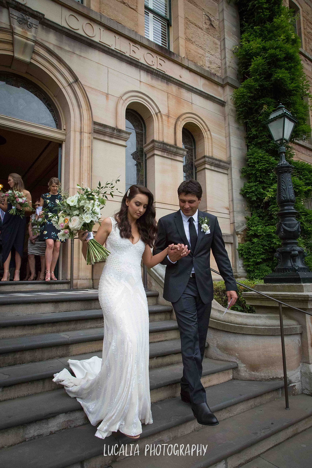 newly married couple walking down the steps of a historic building, Wairarapa wedding photographer