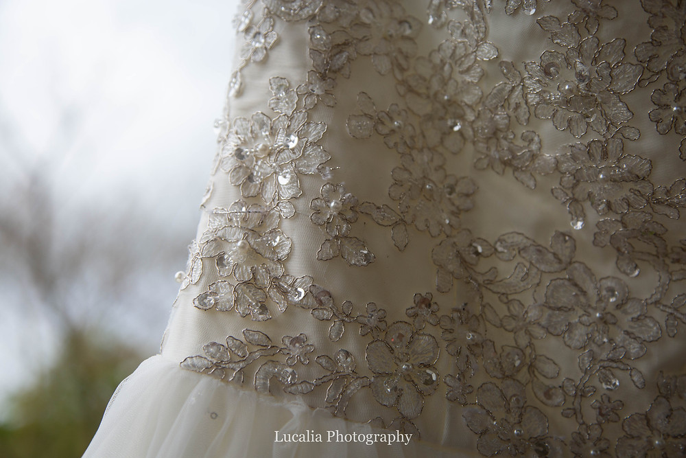 detail of wedding dress with lace flowers and sequins, Wairarapa wedding photographer