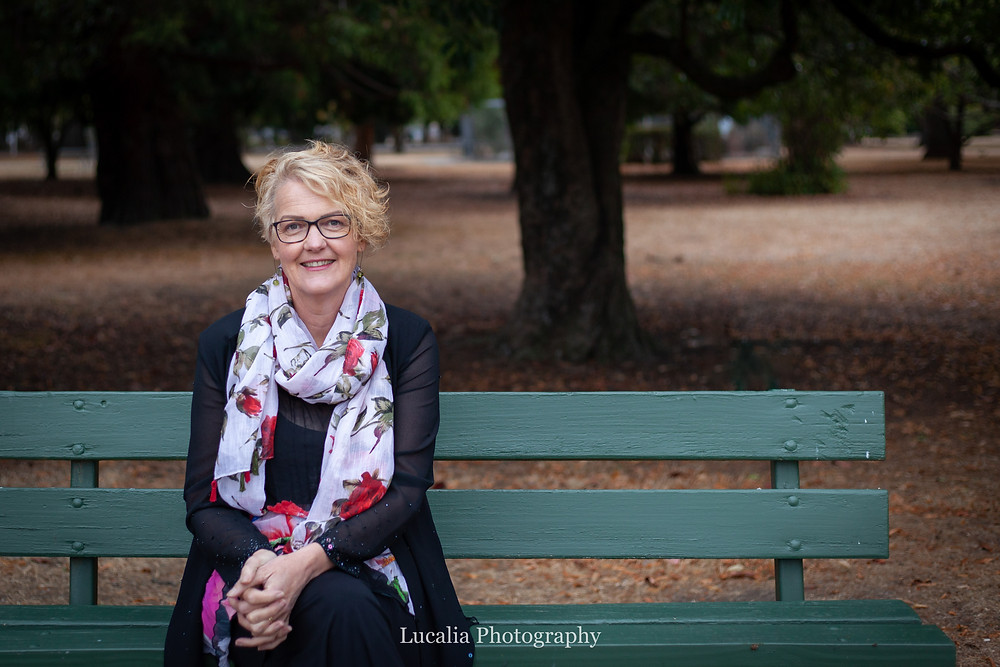 Wairarapa wedding celebrant Rachel Clarke sitting on a park bench