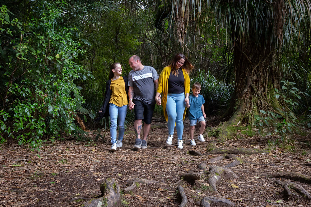 family walking through forest Waiohine Gorge, Wairarapa family photographer