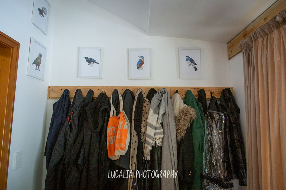 framed NZ native bird prints above winter coat hooks, Mount Holdsworth, Wairarapa family photographer