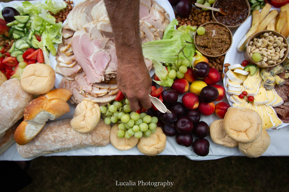person gathering lunch from wedding reception grazing table, Wairarapa wedding photographers