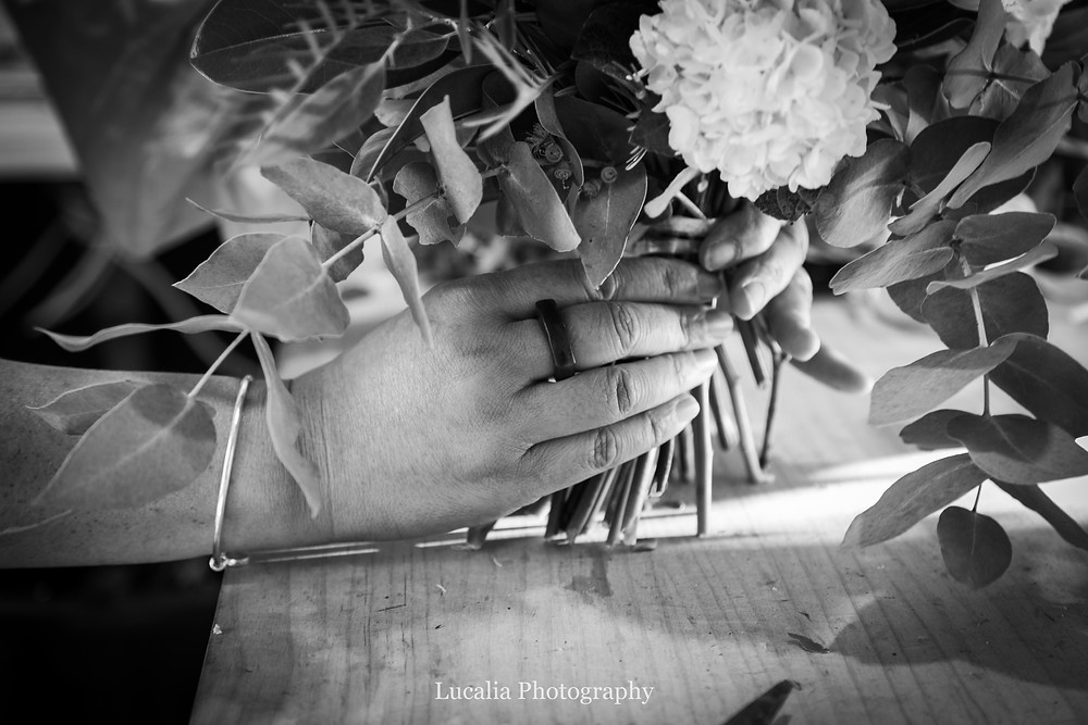 florist wearing a pounamu ring holds wedding flowers, Wairarapa