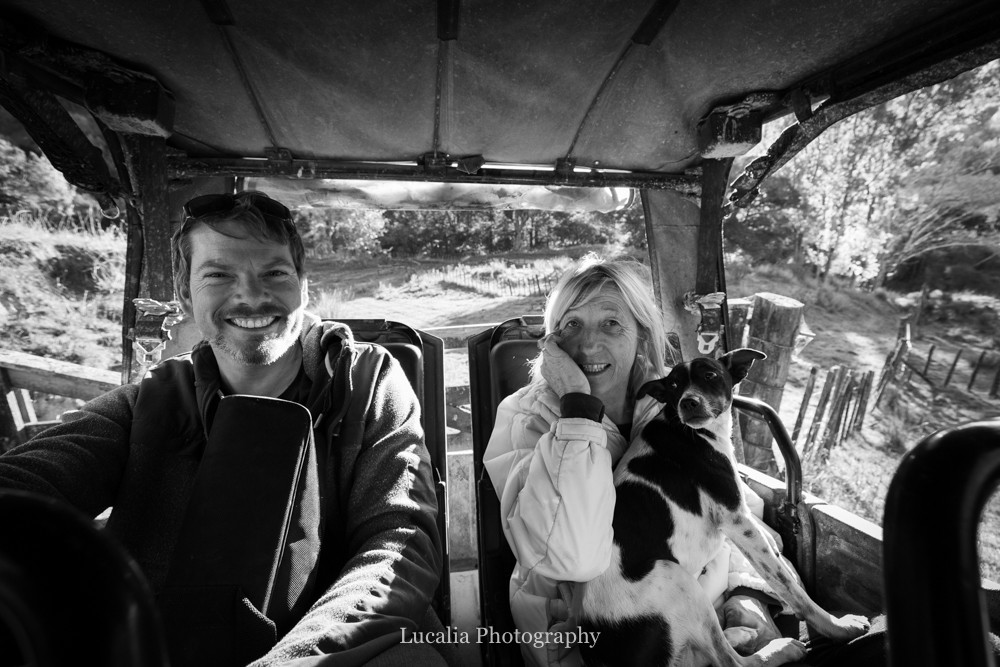 husband and host with little dog on quad bike smiling, High Peaks Farm Stay, Mangamahu, Manawatu-Wanganui, New Zealand
