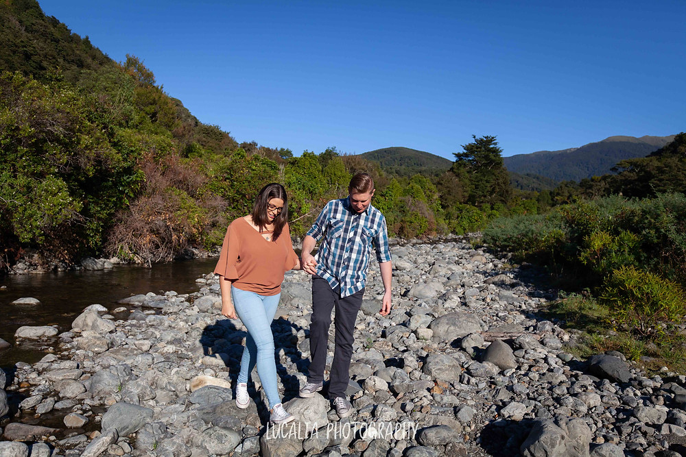 couple walking across riverbank, Mt Holdsworth, Wairarapa wedding photographer