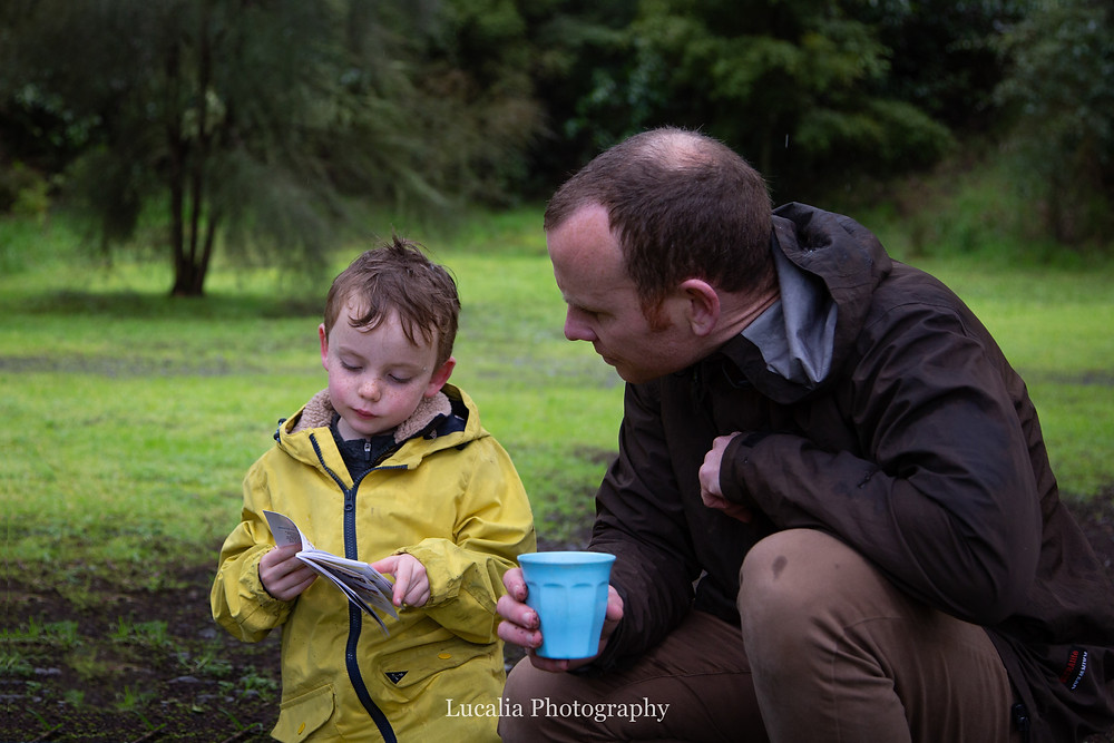 father a son looking at an insect identification book, Wairarapa family photographer