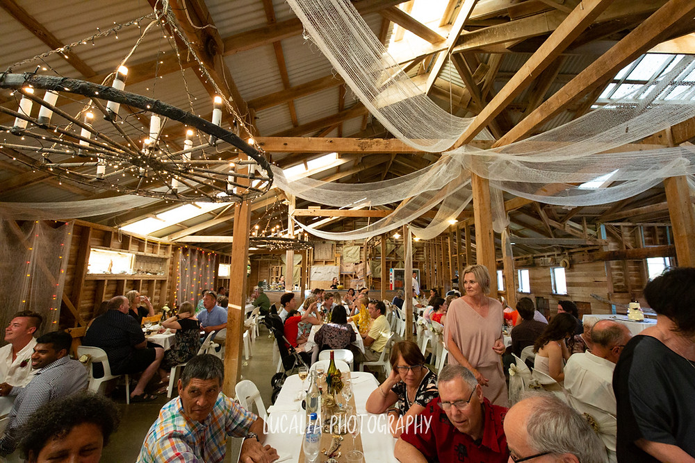fairy lights, draping and candles at the Woolshed, Castlepoint Wairarapa wedding, Lucalia Photography
