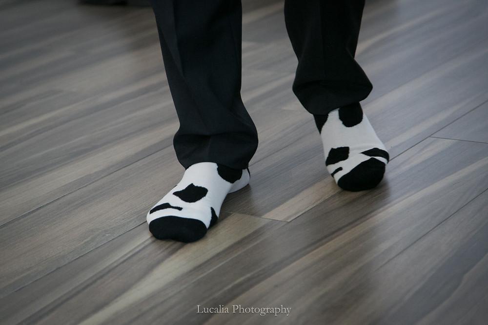 groom's feet wearing cow print socks