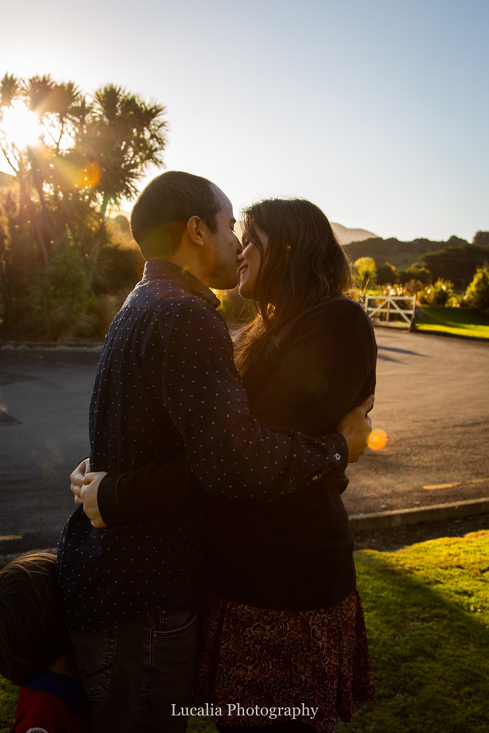 parents cuddling in afternoon light, Wairarapa family photographer