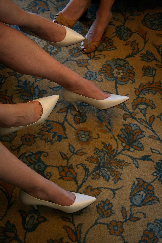 bridesmaids shoes on flower patterned carpet