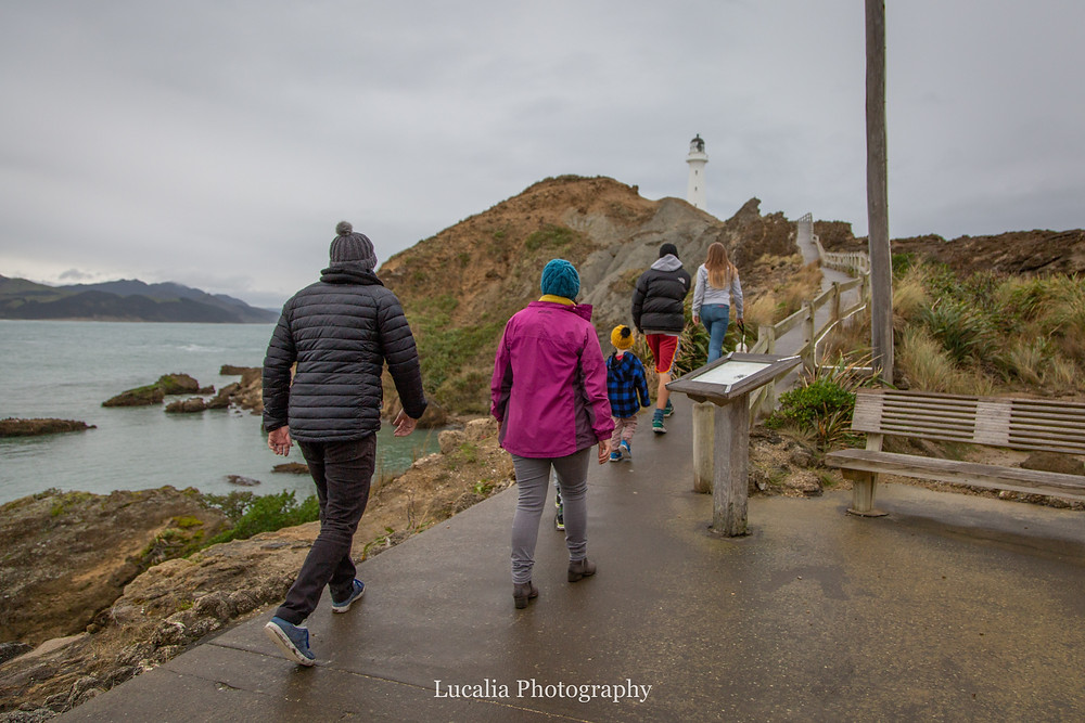 family walking up to the lighthouse, Castlepoint Wairarapa family photographer
