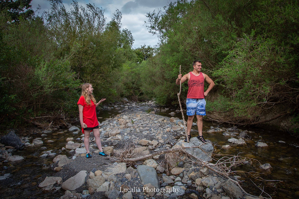 engaged couple standing in a river bed, acting, Featherston Wairarapa
