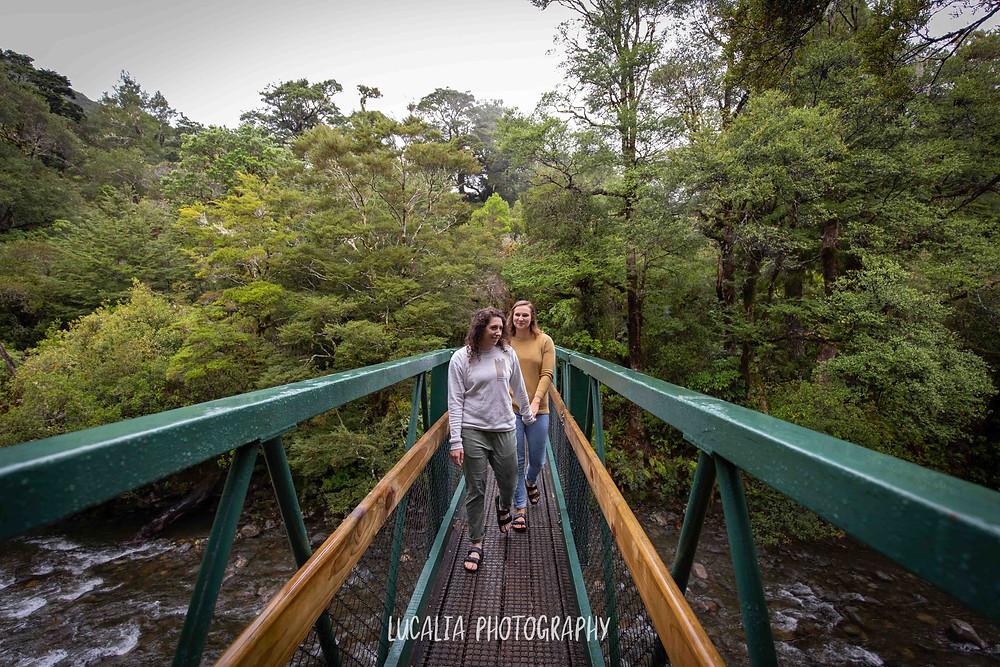 engaged couple walking across bridge at Mt Holdsworth, Wairarapa