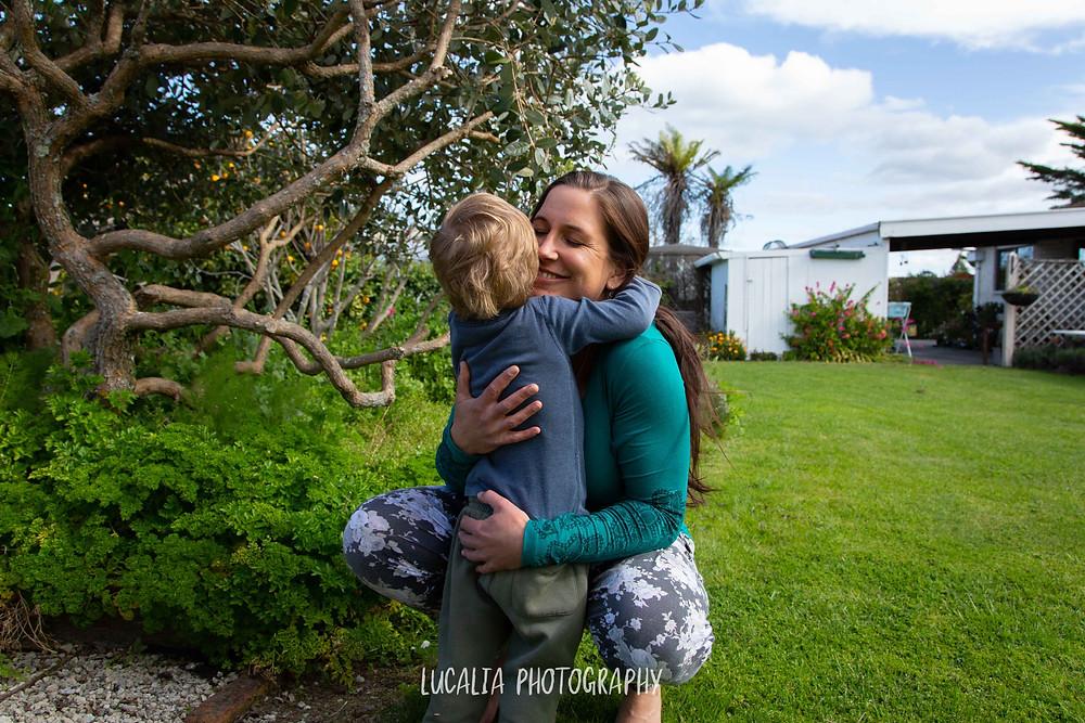 mum hugging her son in a garden, Wairarapa maternity photographer