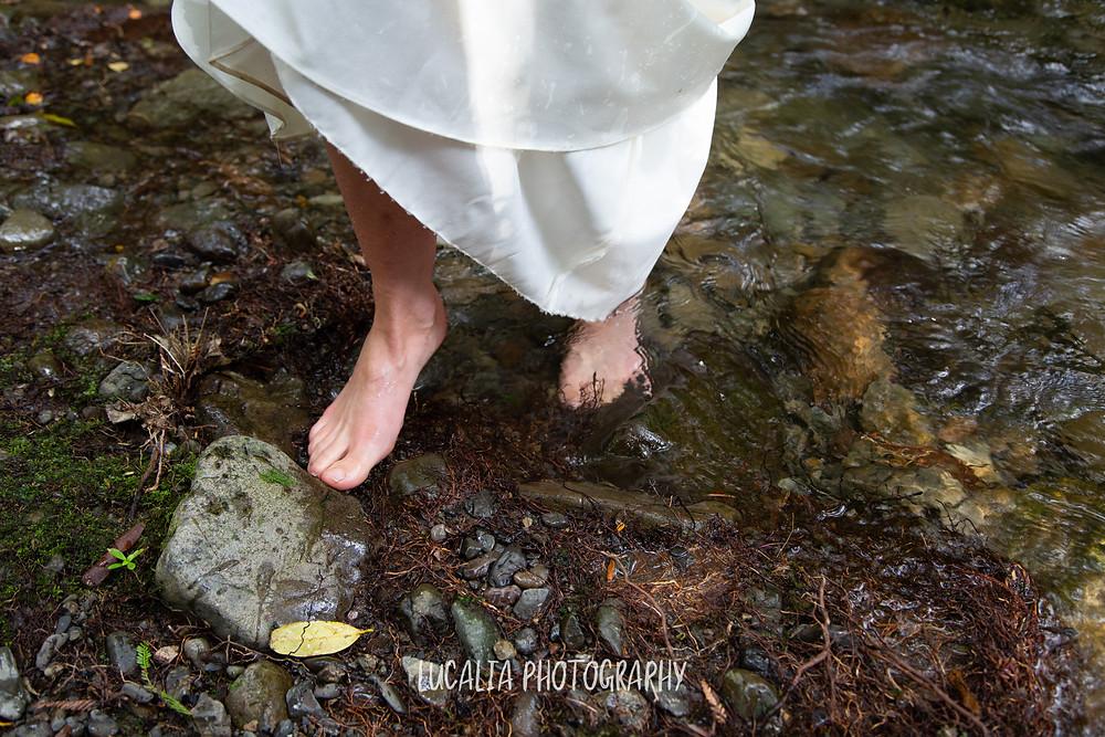 bride's feet walking out of a river wearing wedding dress, Kiriwhakapapa Wairarapa wedding photographer