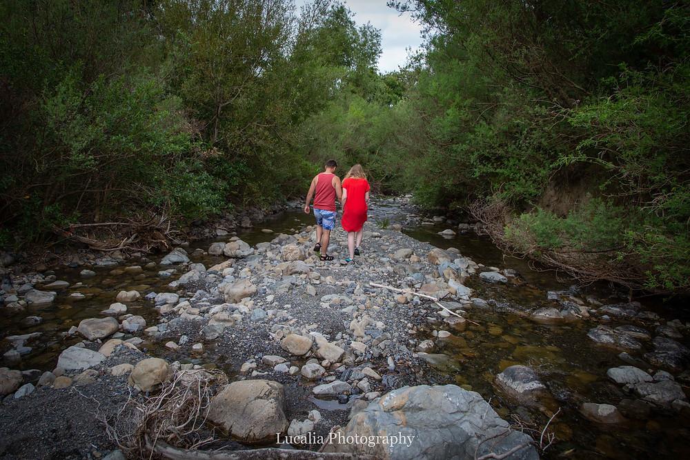 engaged couple walking away down a river, Featherston Wairarapa