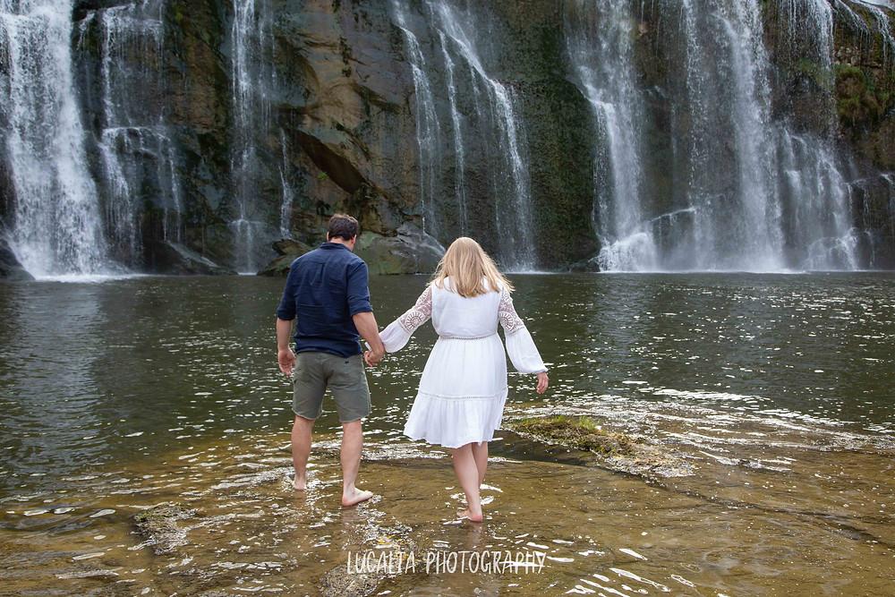 pregnant couple walking in waterfall, Wahi Falls, Tararua, Lucalia Photography