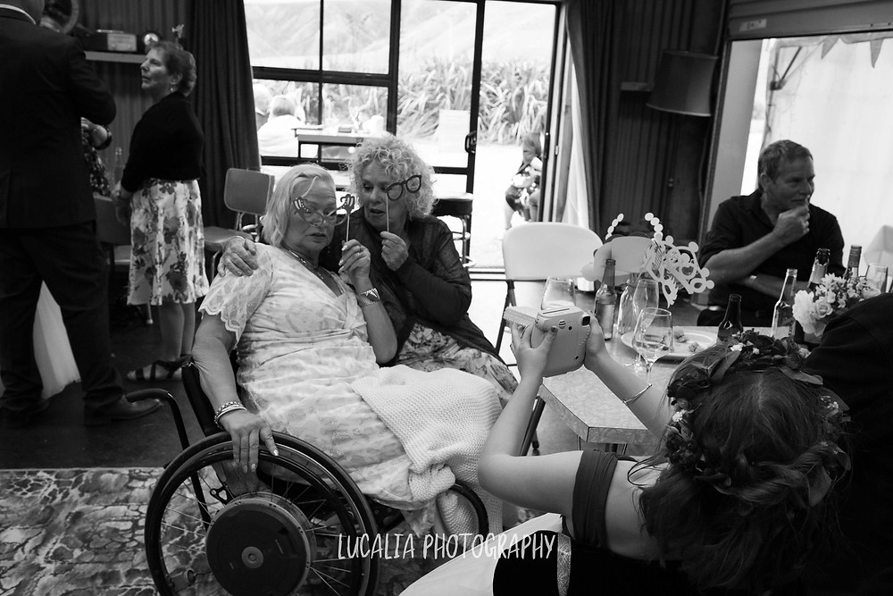 wedding guests with props and Instax camera, Ngawi Wairarapa wedding photographer