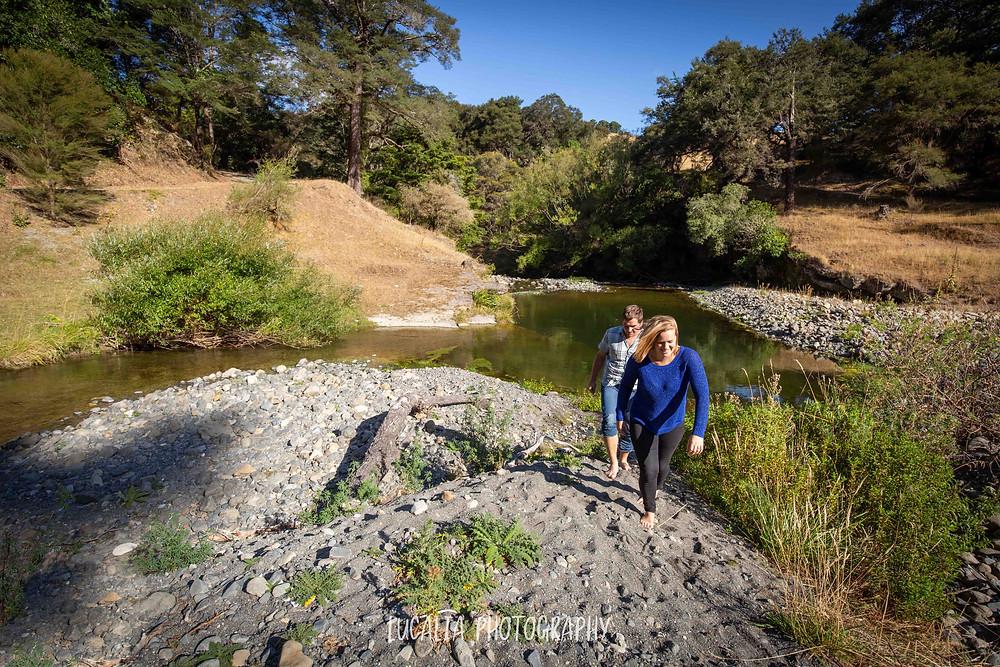 couple walking up river bank, Martinborough Wairarapa wedding photographer