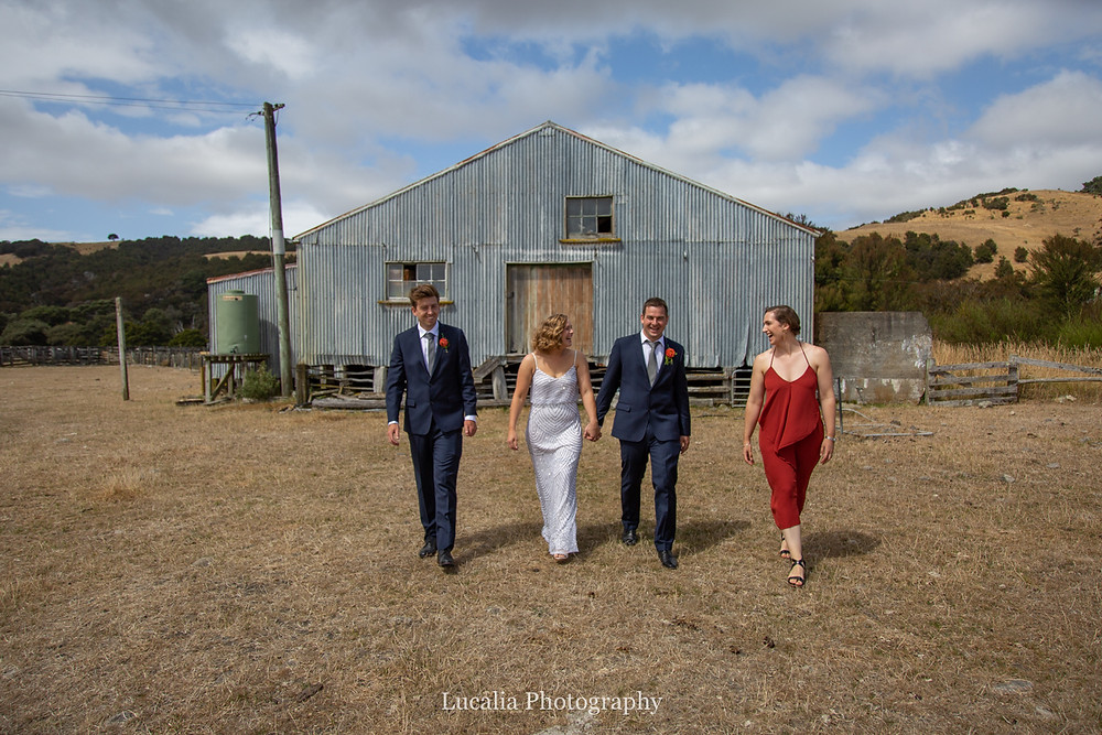 wedding party walking outside woodshed, Wairarapa wedding photographers